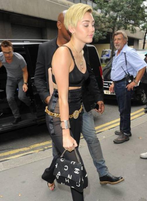 miley cyrus with chanel print bag