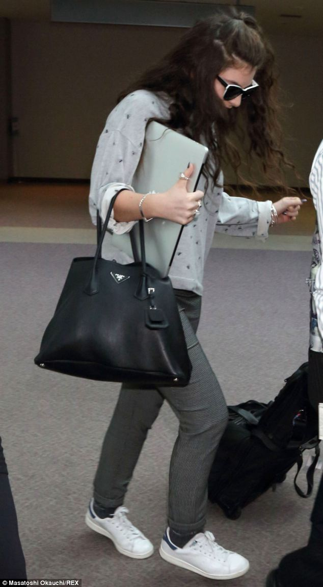 Songstress Lorde Seen Carrying a Black Prada Tote in Japan