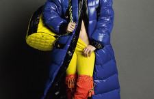 Katy Perry posing provocatively in bright colors holding on to a large moschino yellow quilted bag. Courtesy: Moshino